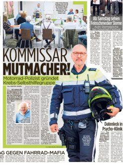 Zeitungsausschnitt mit Polizist